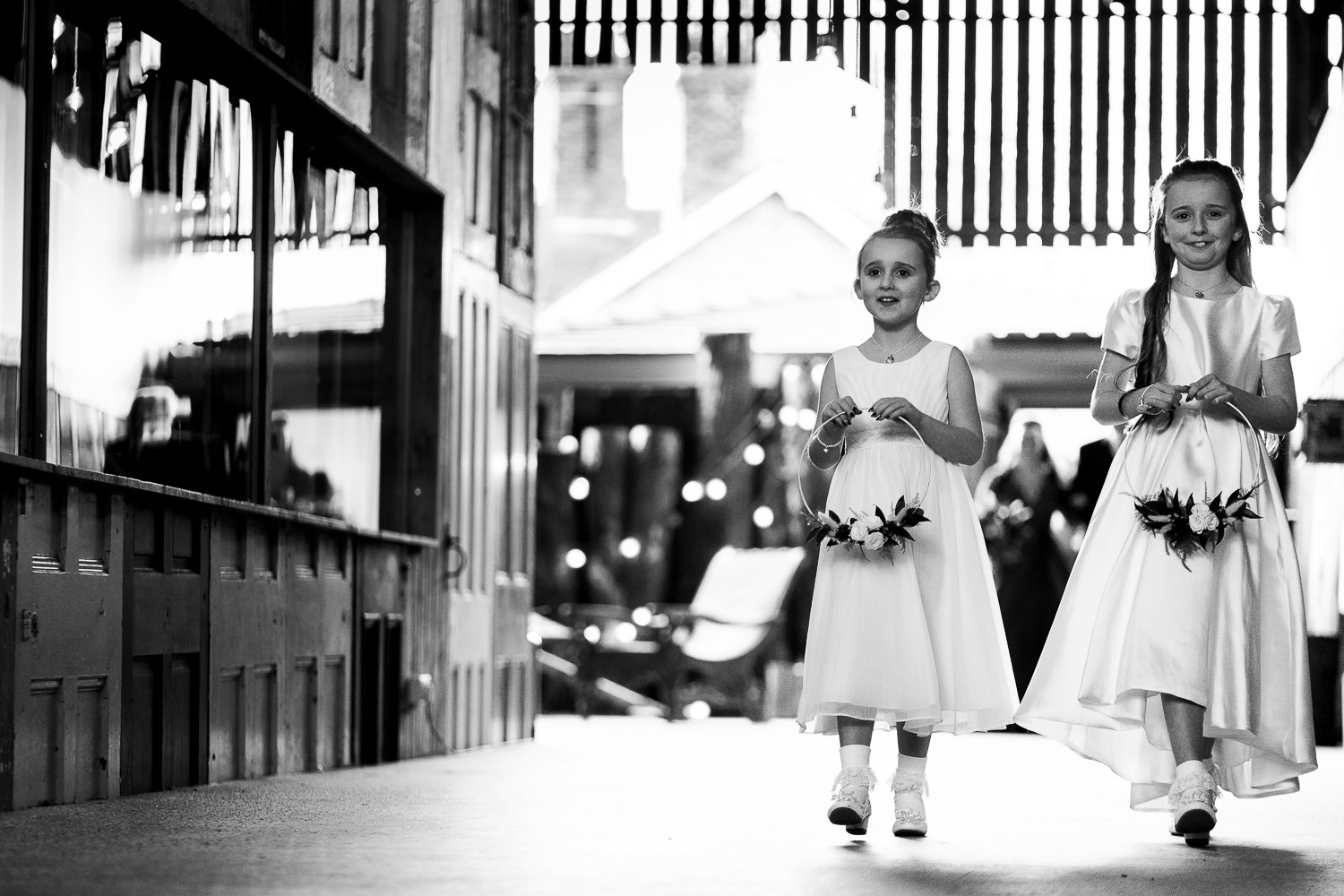 Flower girls walking to the ceremony