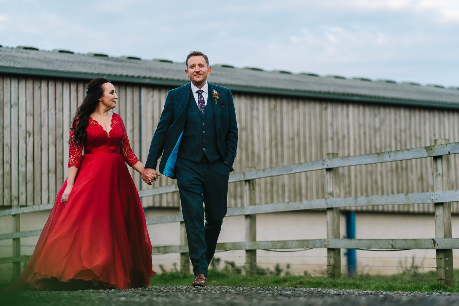 Bride and groom walking at Owen House barn