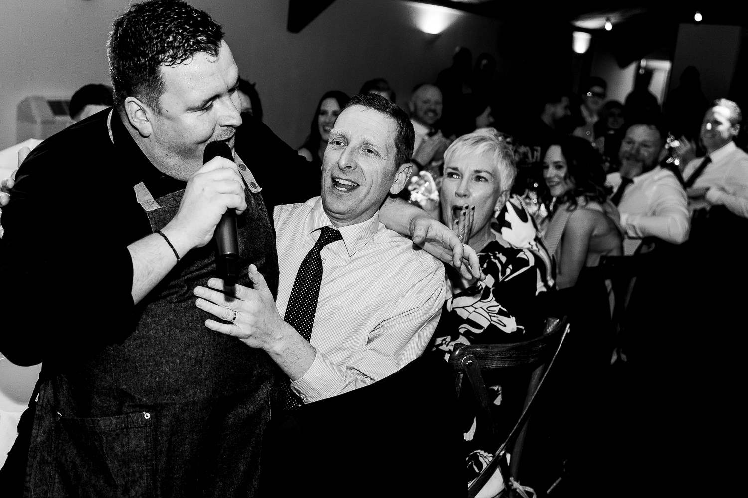 Singing waiter sitting on guests knee