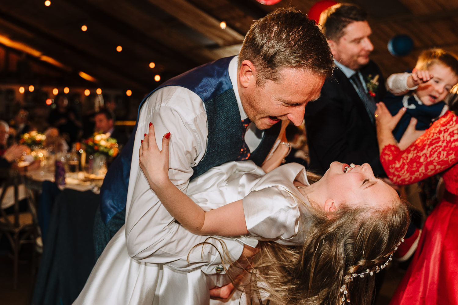 Groom dancing with his daughter