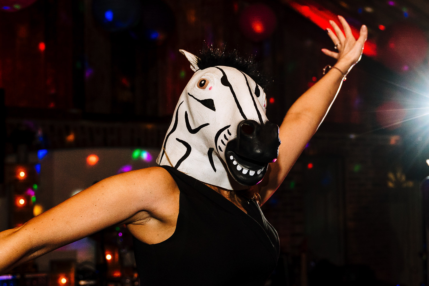Guest dancing with a zebra hat