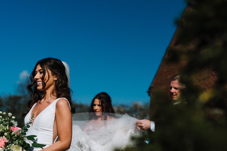 Bride waiting to go in at Sandhole Oak Barn