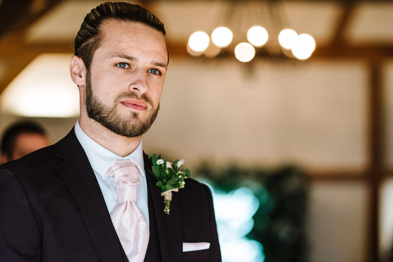 The groom waiting at Sandhole Oak Barn