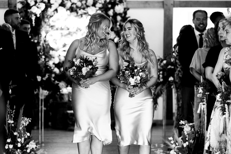 Bridesmaids walking in at Sandhole Oak Barn