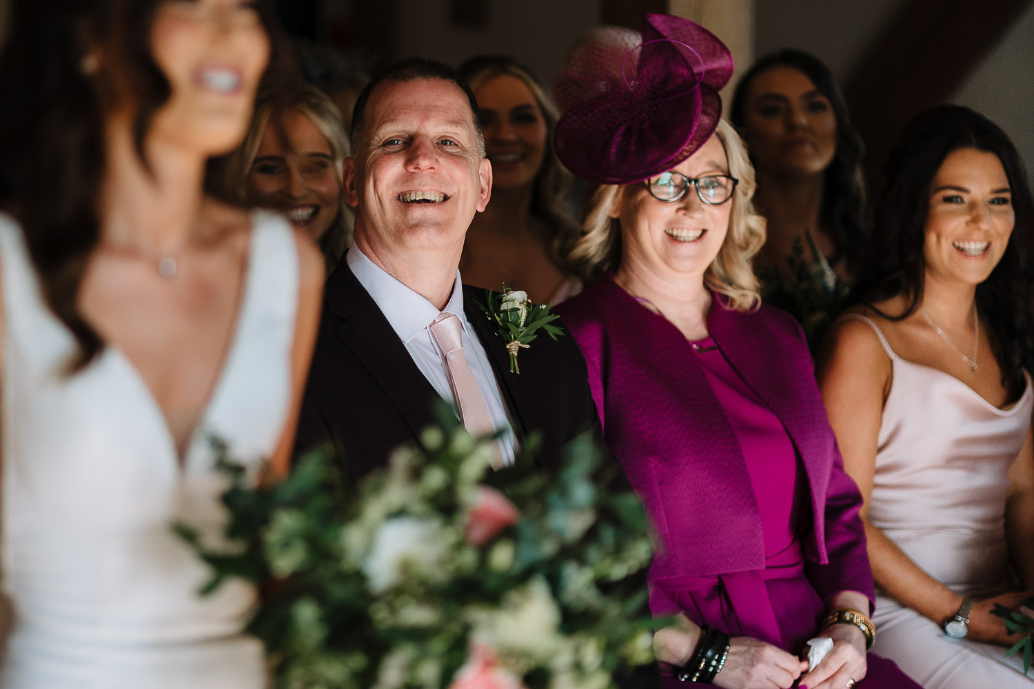 Parents of the bride looking on at Sandhole Oak Barn