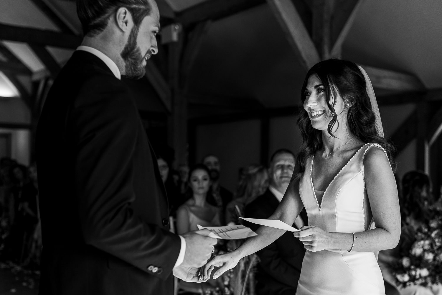 Bride and groom saying their vows at Sandhole Oak Barn