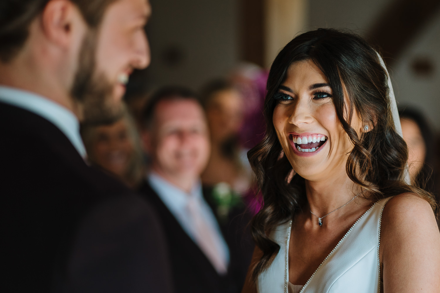 Bride laughing during the vows