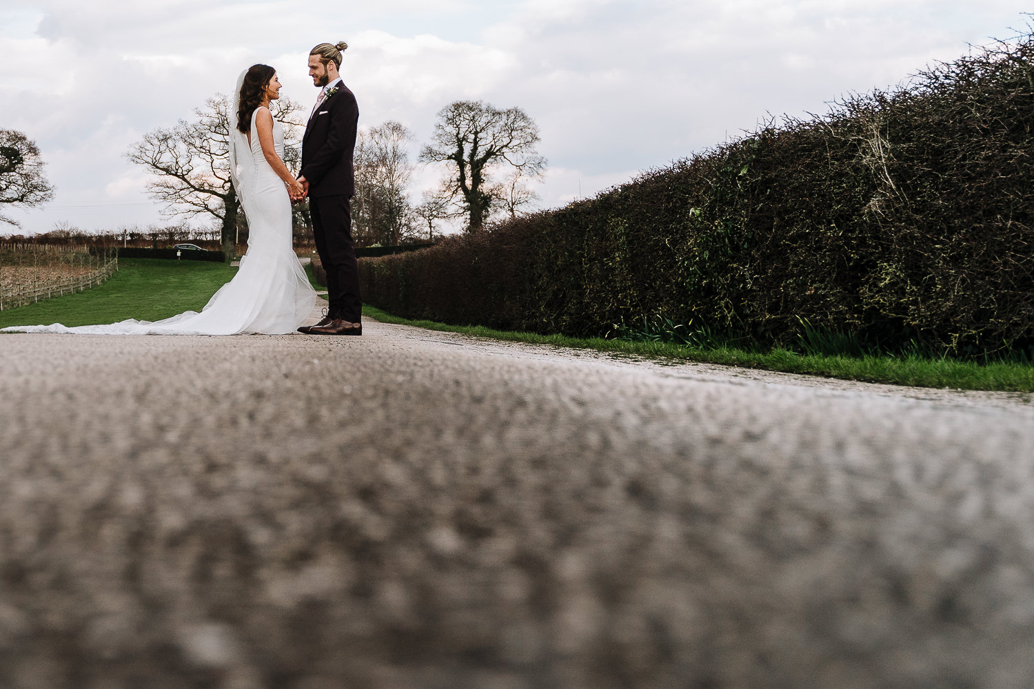photo of the bride and groom on the drive