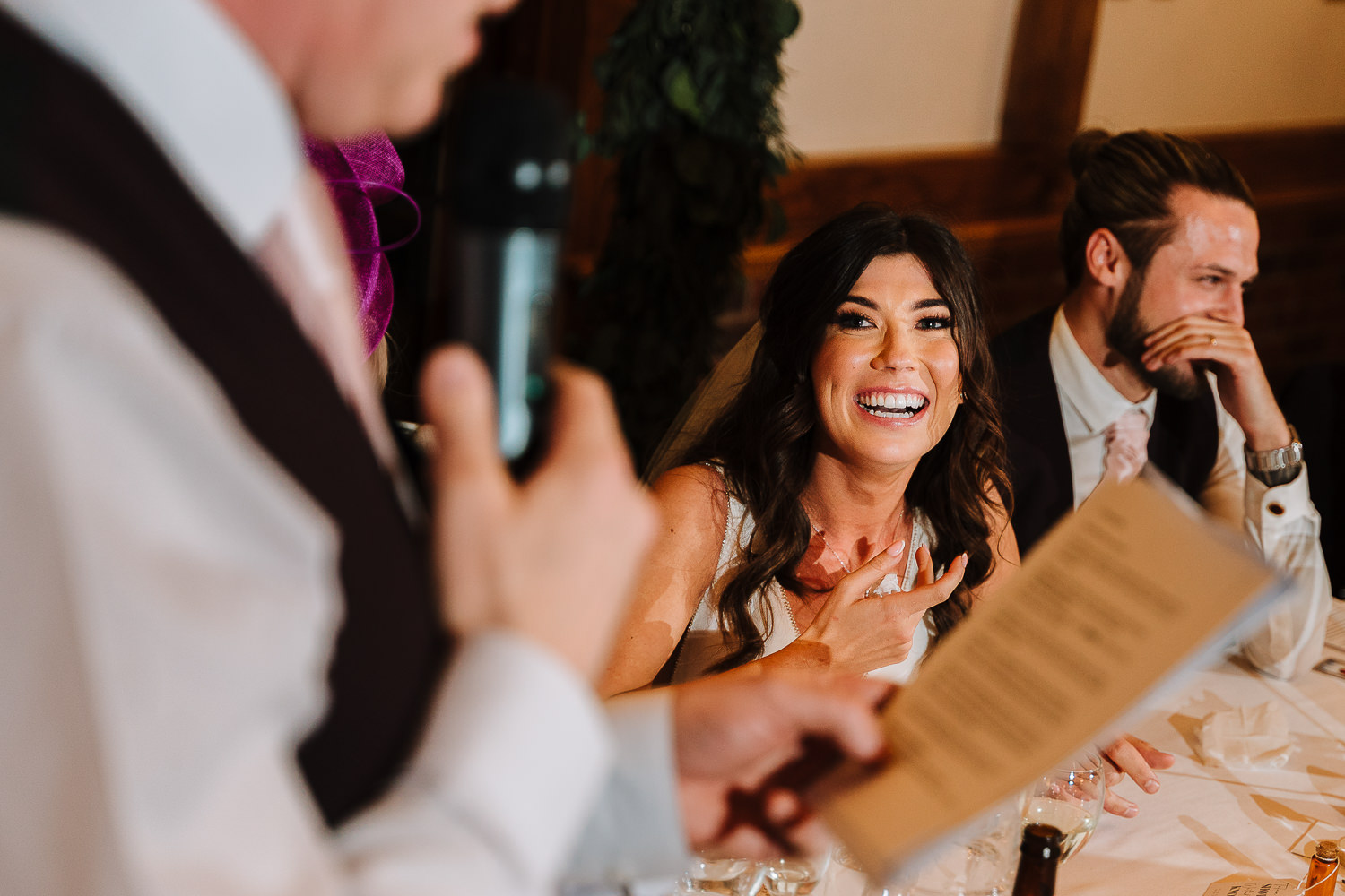 Bride laughing during the speech