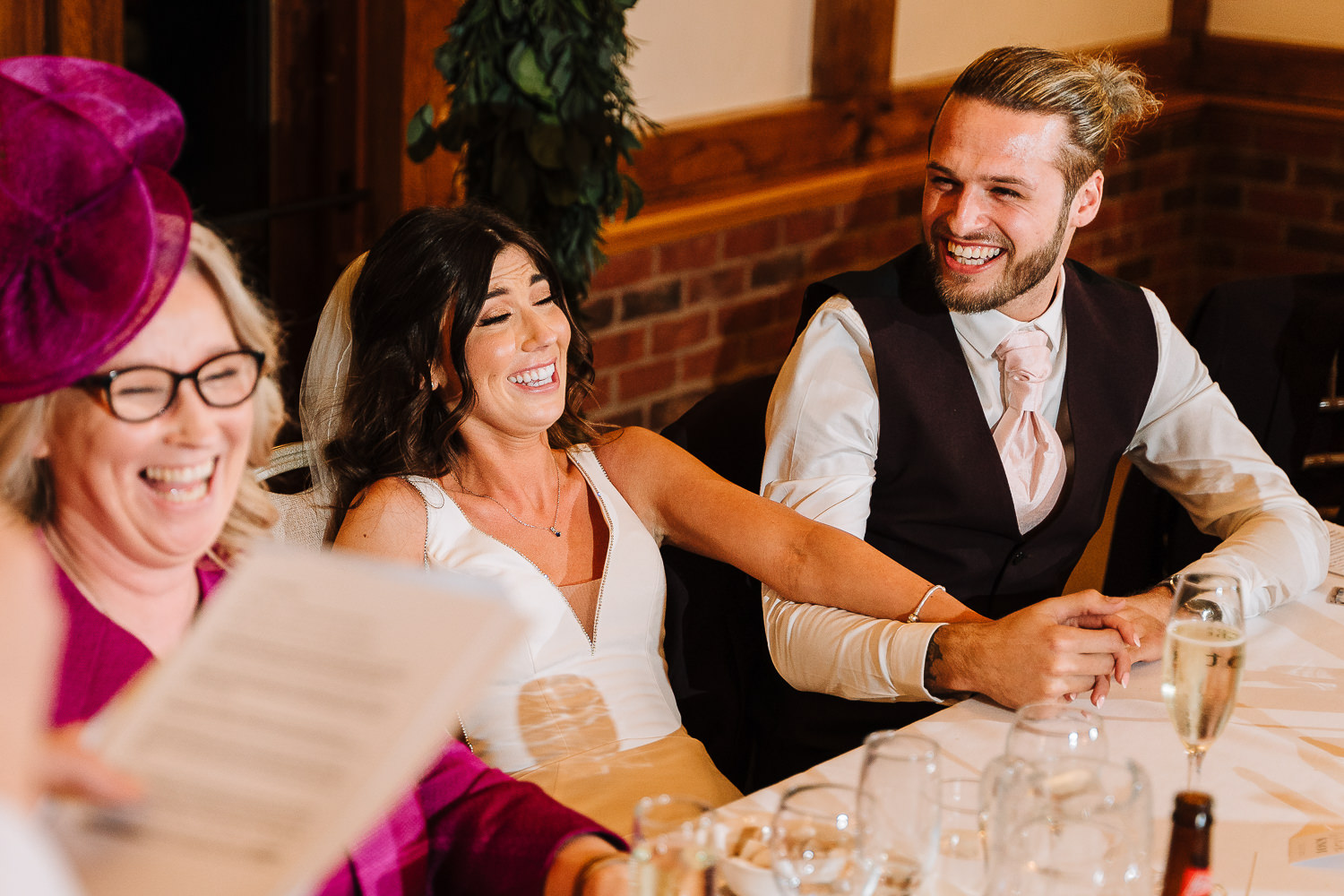 bride and groom laughing at top table