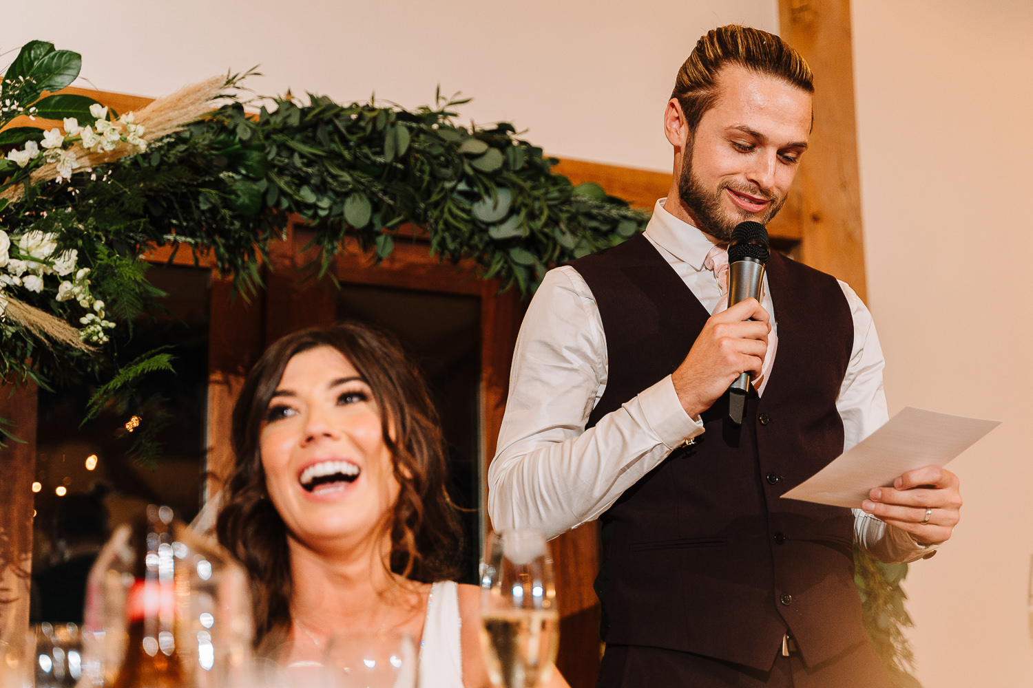 Grooms speech and bride laughing