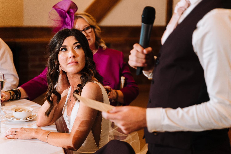 Bride looking on