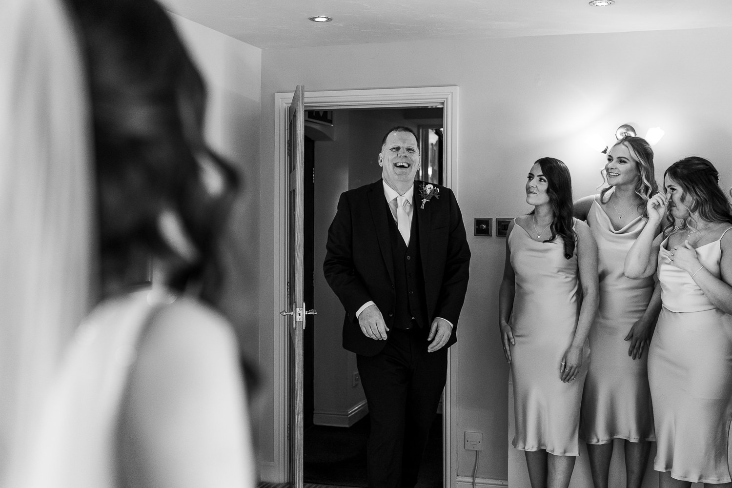 Dad seeing the bride for the first time and laughing