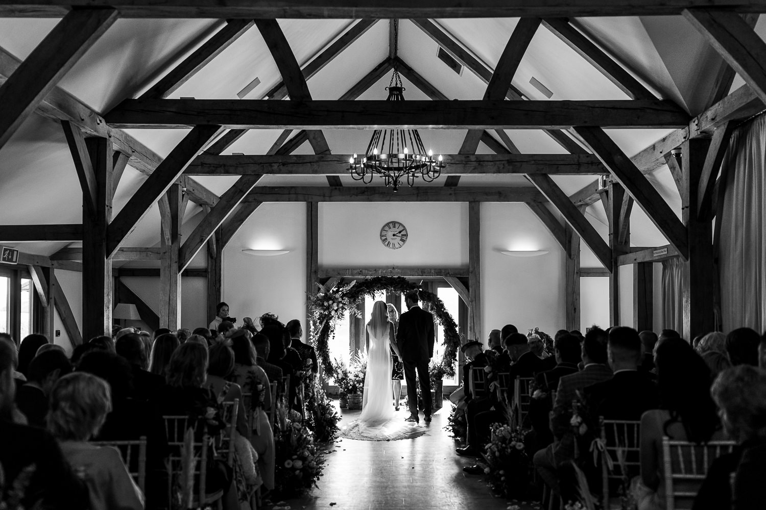 Photo of the ceremony at the back of Sandhole Oak Barn