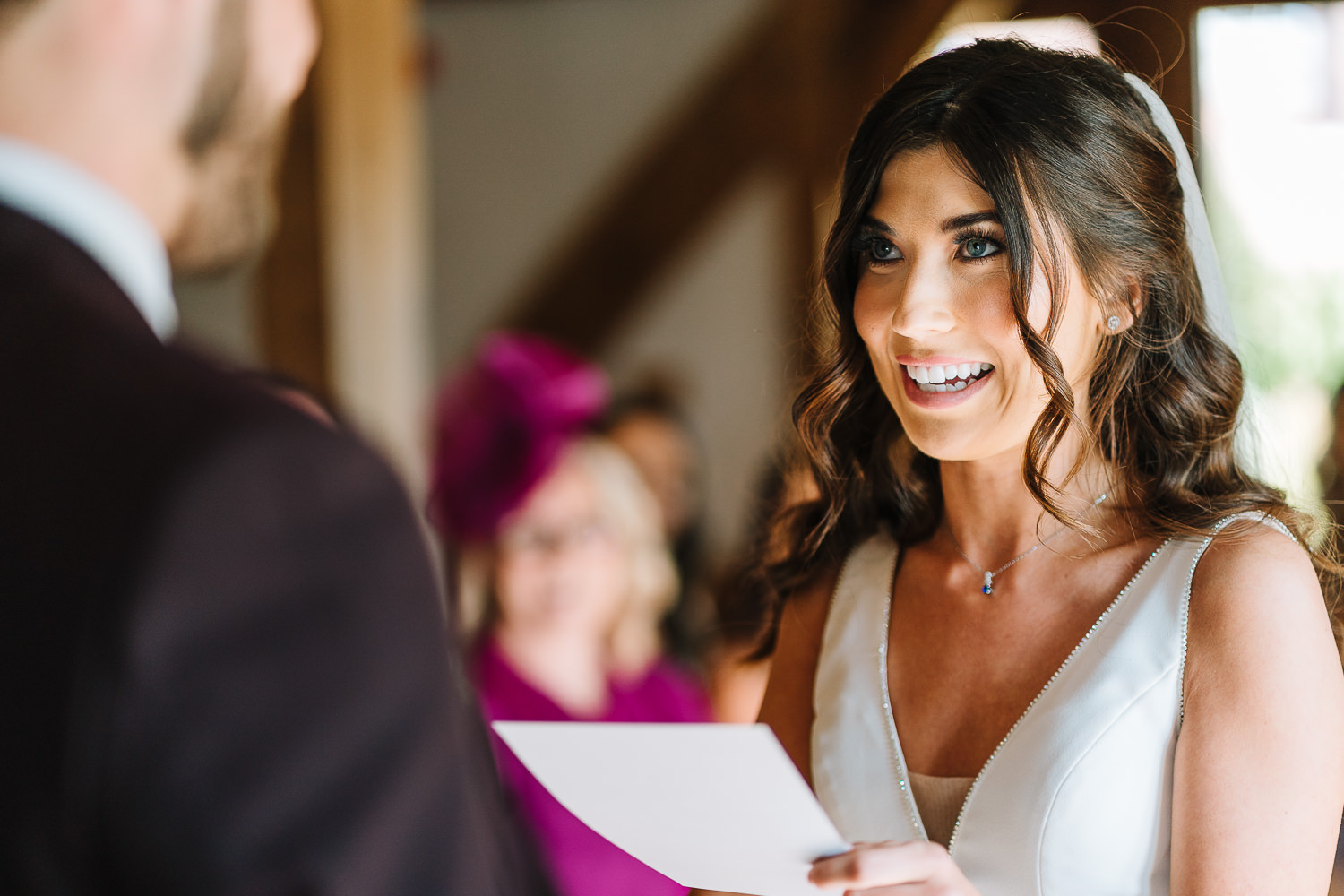 Bride laughing saying her vows