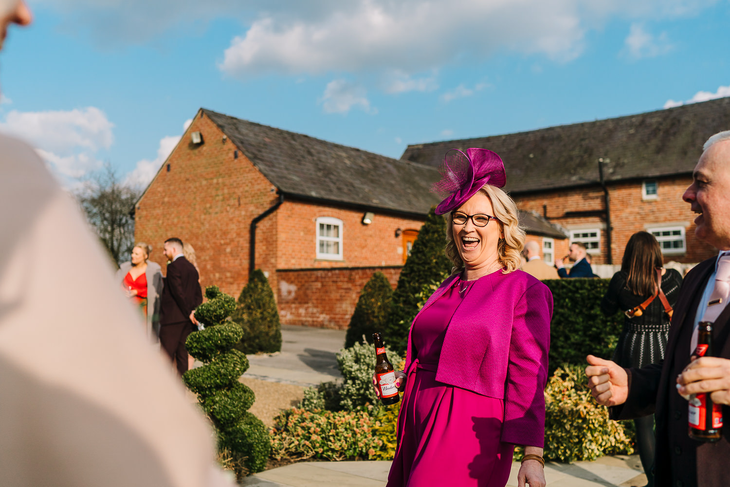 Mother of the bride laughing at Sandhole Oak Barn