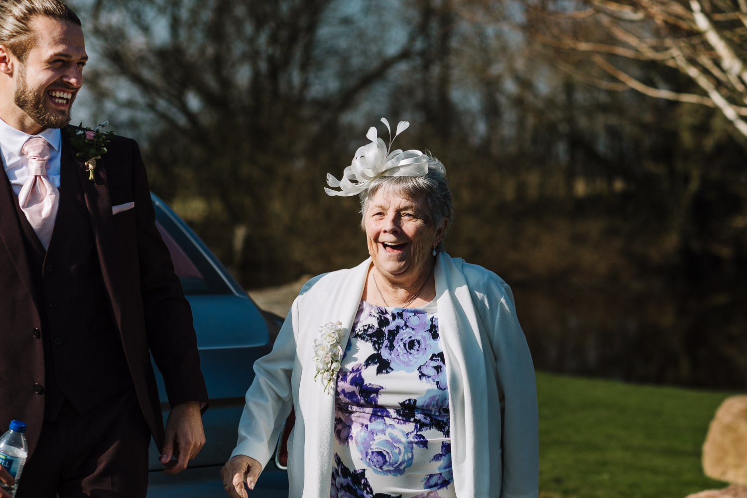 Groom laughing with his nan at Sandhole before the ceremony