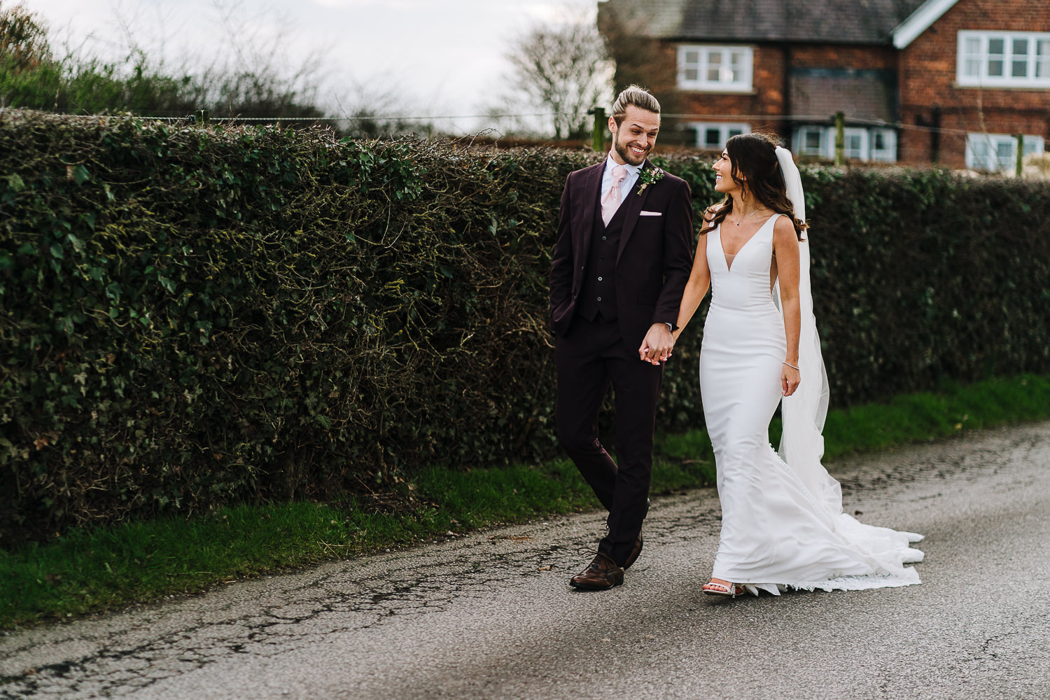Bride and groom laughing at Sandhole Oak Barn