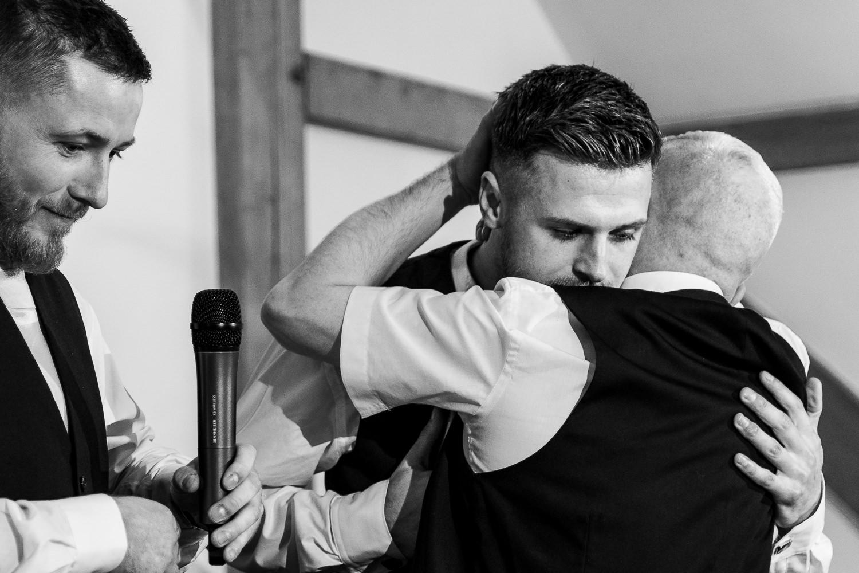 Best man hugging his dad