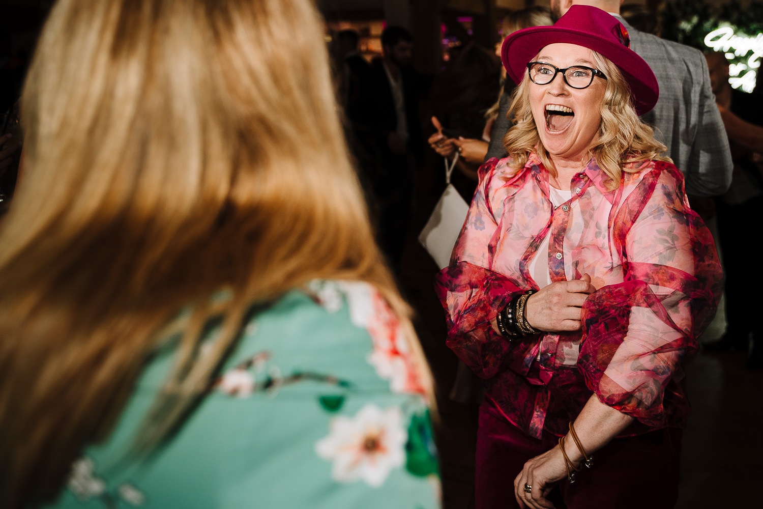 mother of bride dancing with a hat on