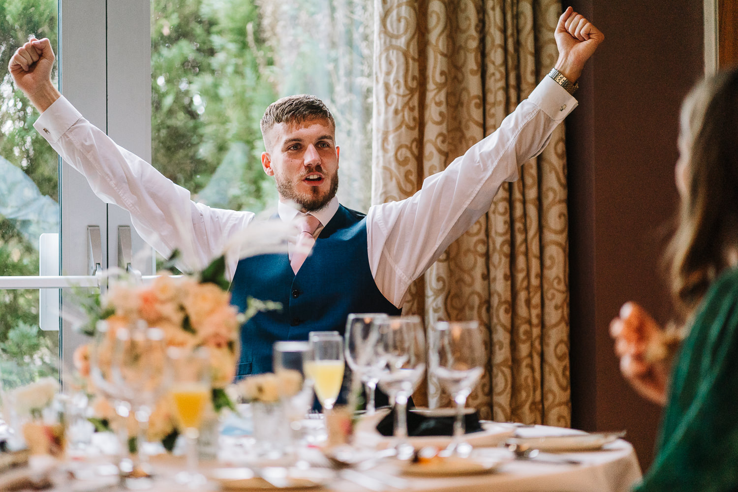 Groomsmen with hands in air