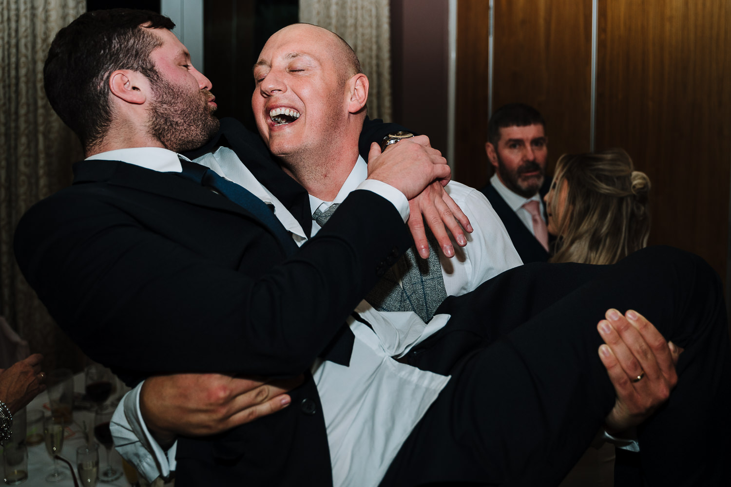 Groom carrying wedding guest