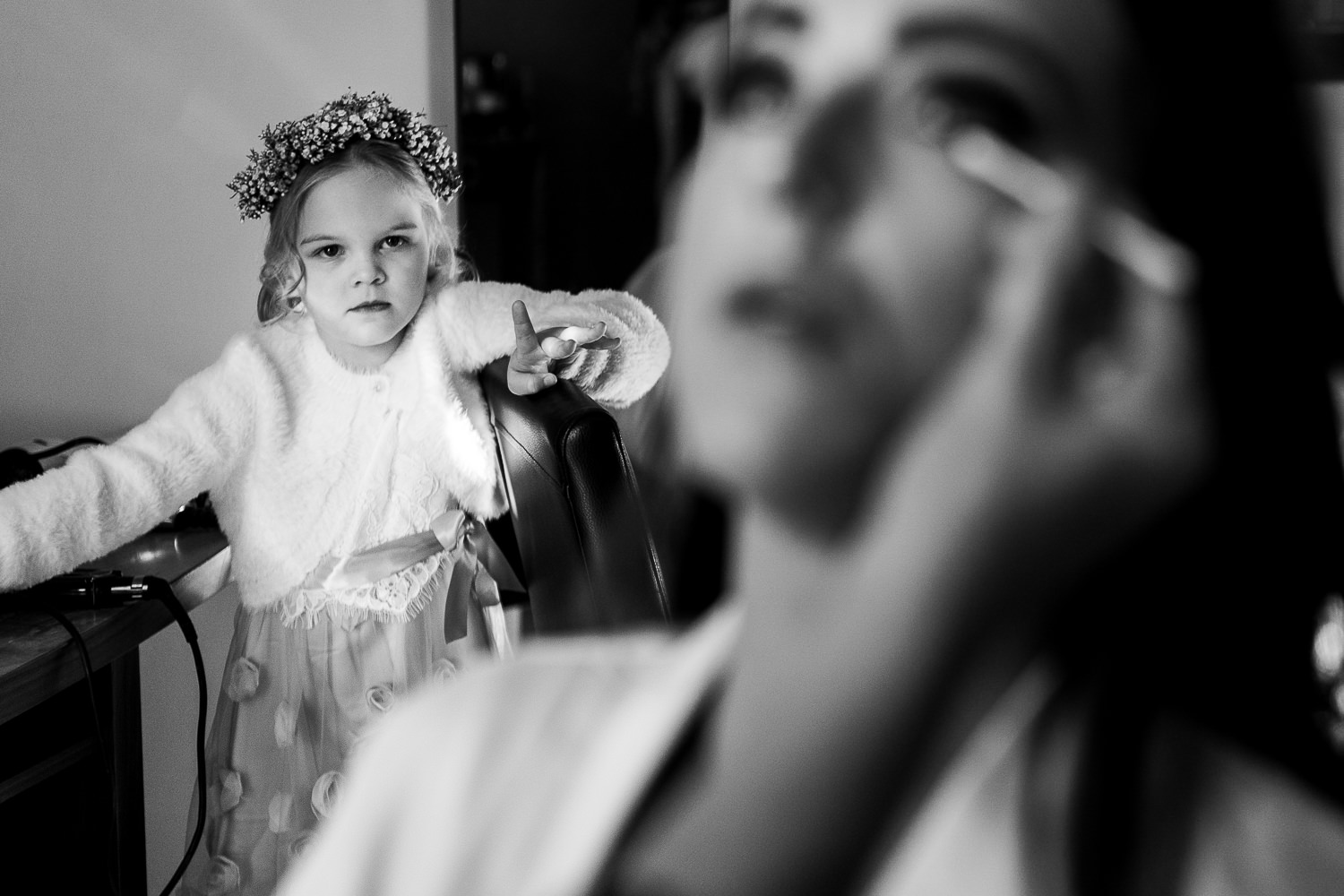 Flower girl looking at her mum have make up