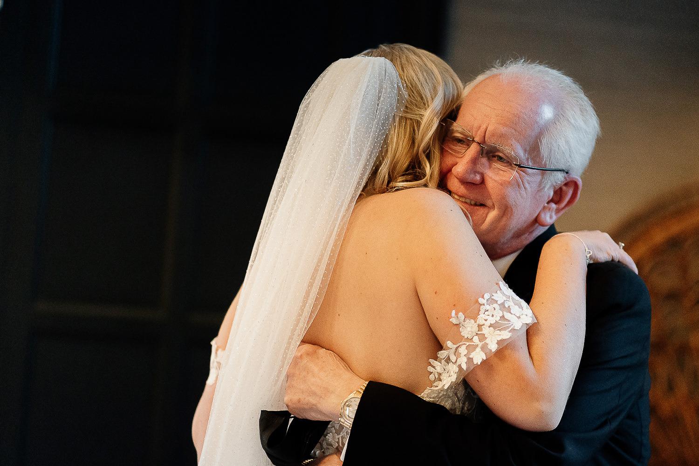 Bride hugging her dad at Falcon Manor