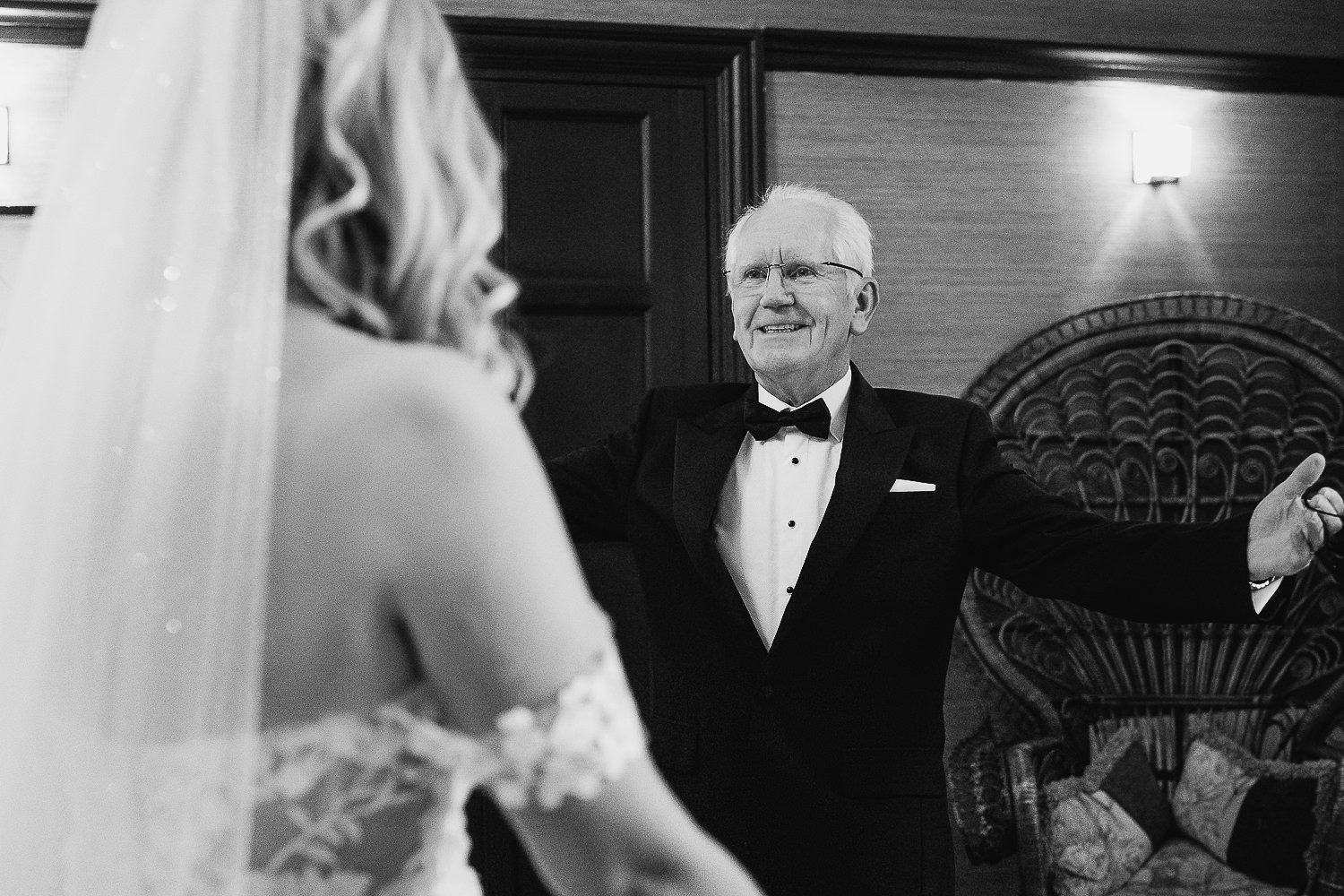 Father of the bride at Falcon Manor opening his arms to hug his daughter