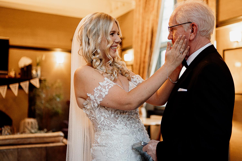 Bride embracing her dad at Falcon Manor