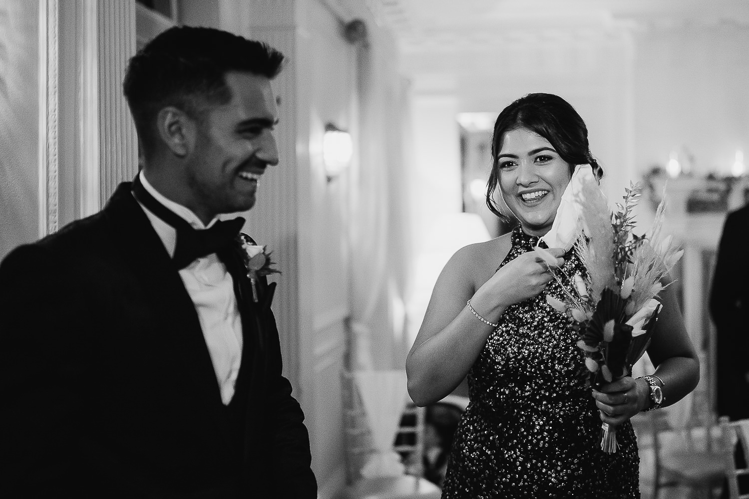 Bridesmaid taking off her mask and laughing