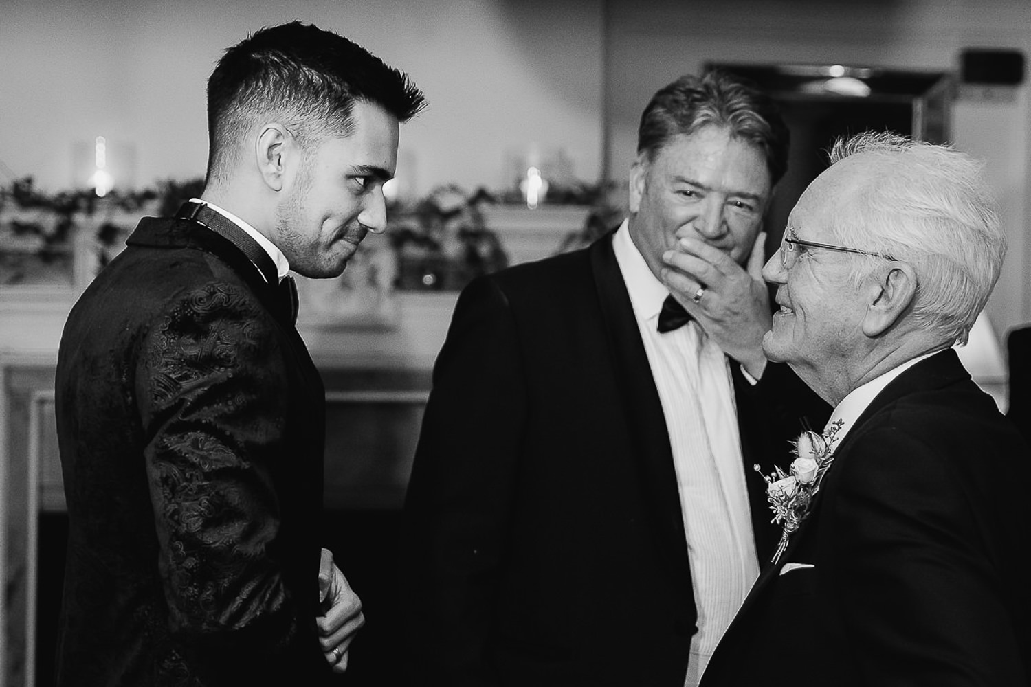 Groom embracing the father of the bride