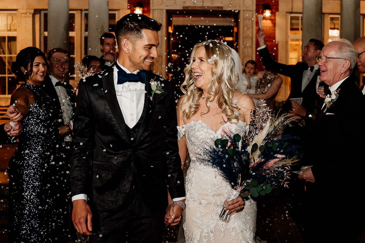 The couple laughing with confetti