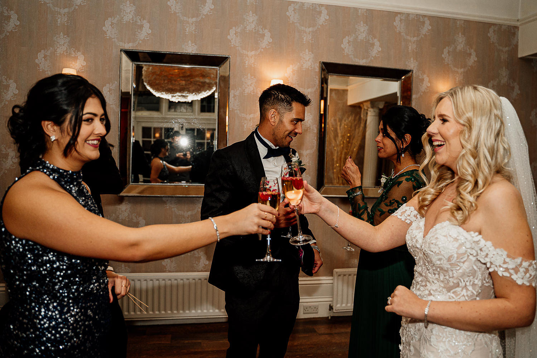 Bride and bridesmaids having a drink