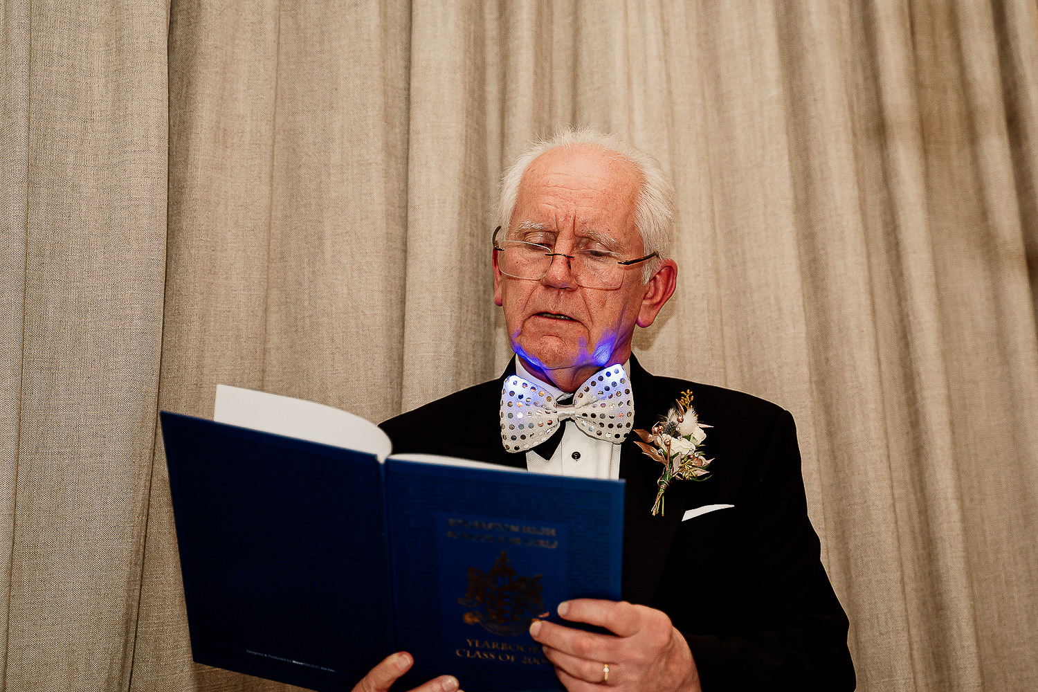 Photo of the father of the bride reading from book