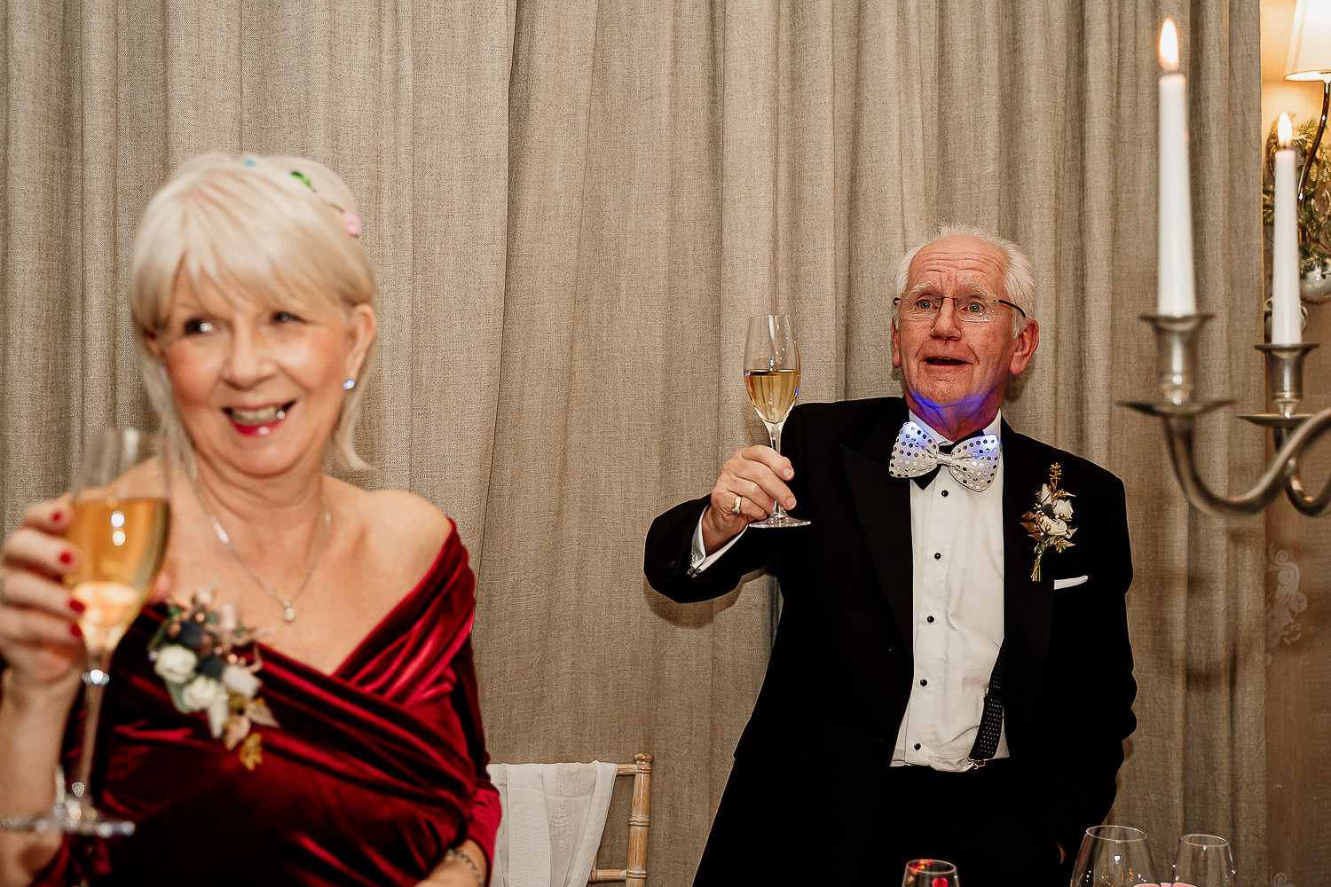 Parents of the bride toasting