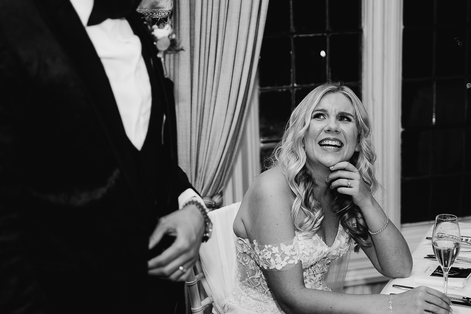 Brides laughing during grooms speech