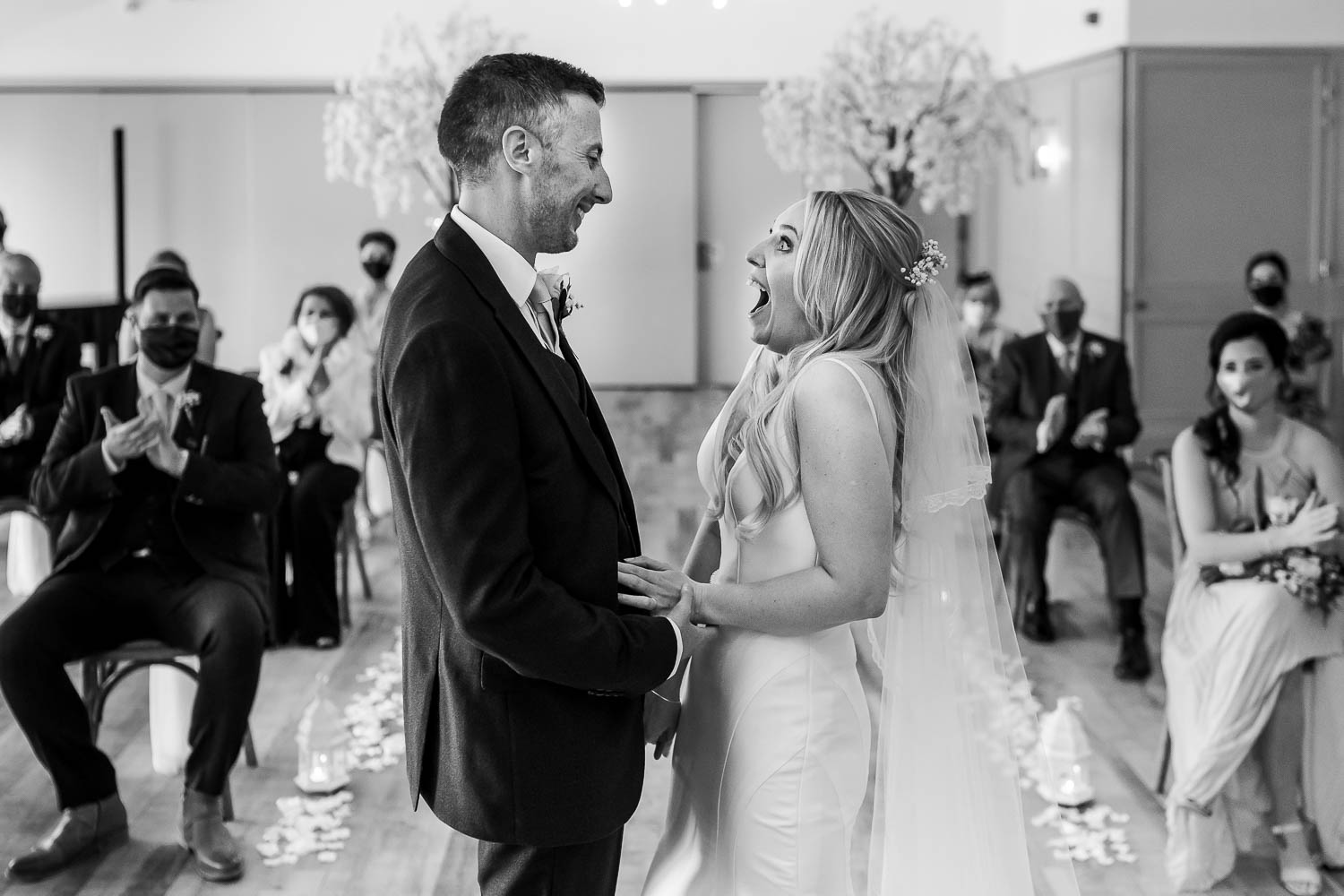 Bride and groom laughing after getting married