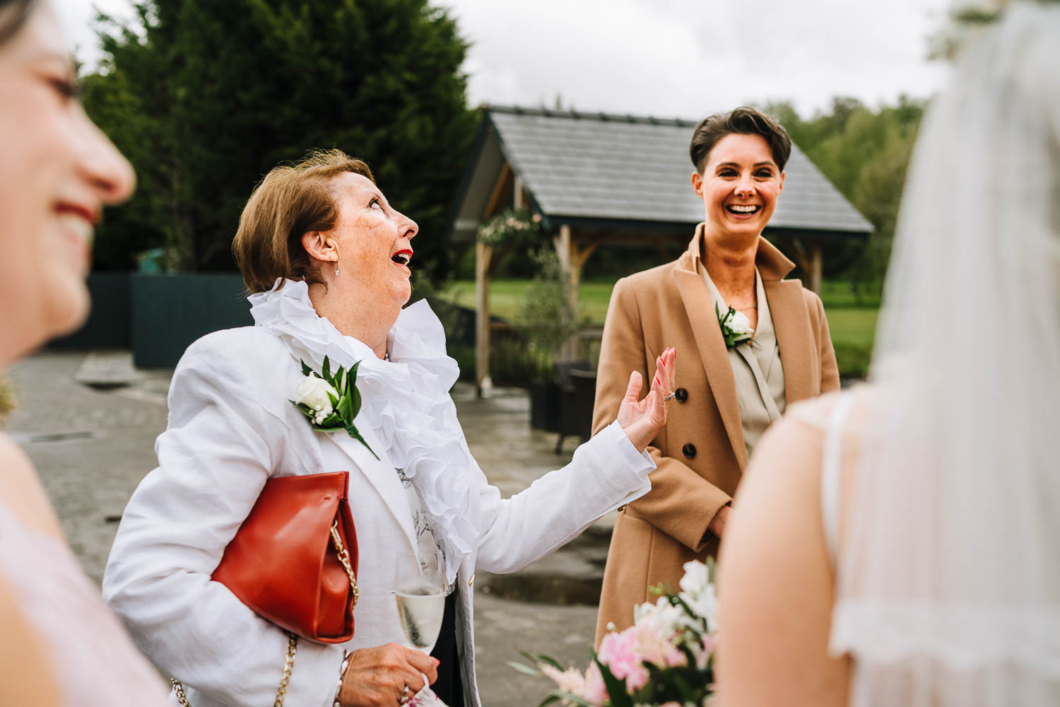 Wedding guests laughing during reception drinks
