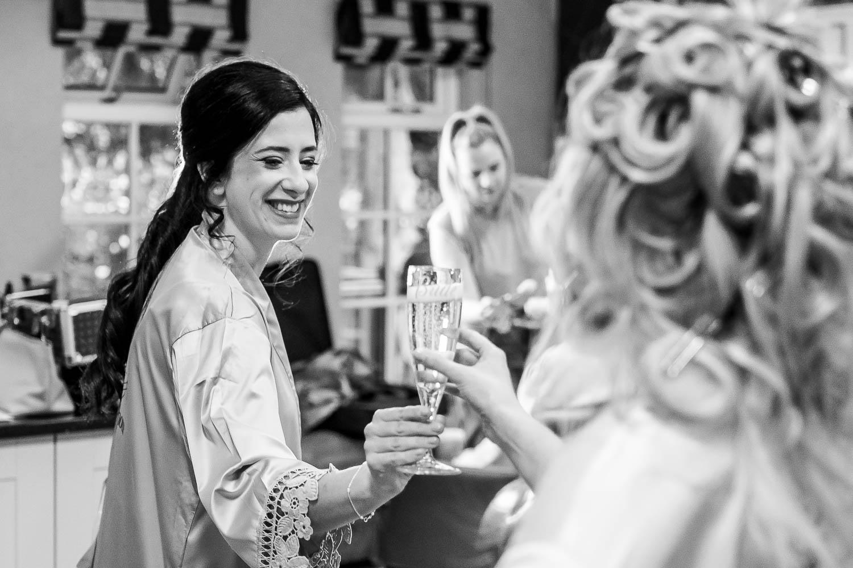 Bride and bridesmaid drinking