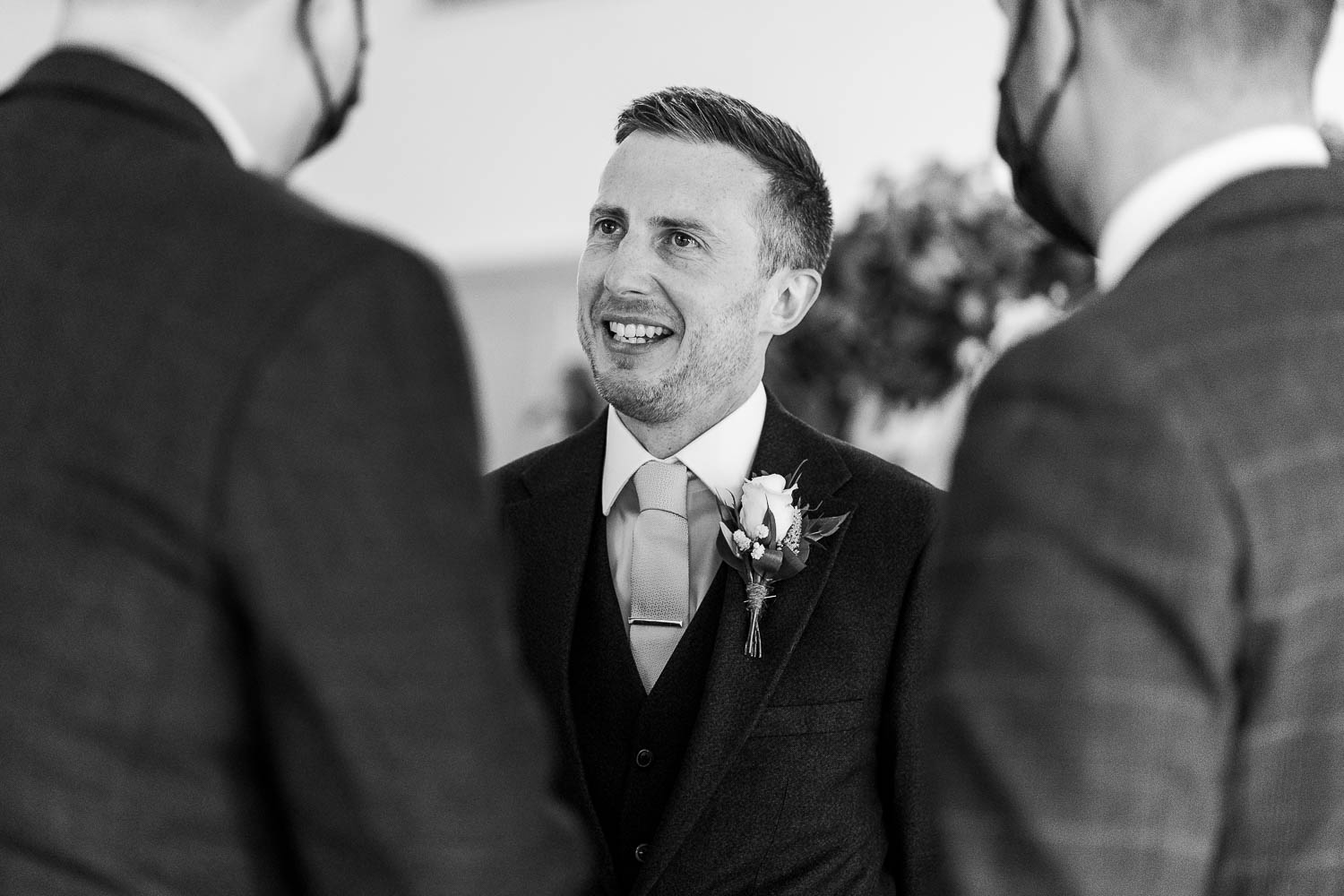 Groom laughing before the wedding