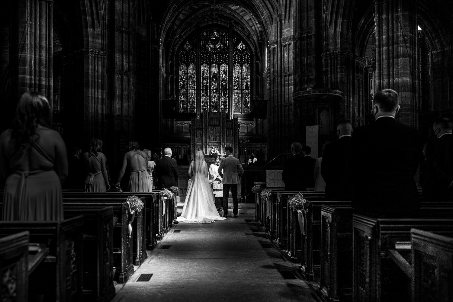 Photo of bride and groom from back of church
