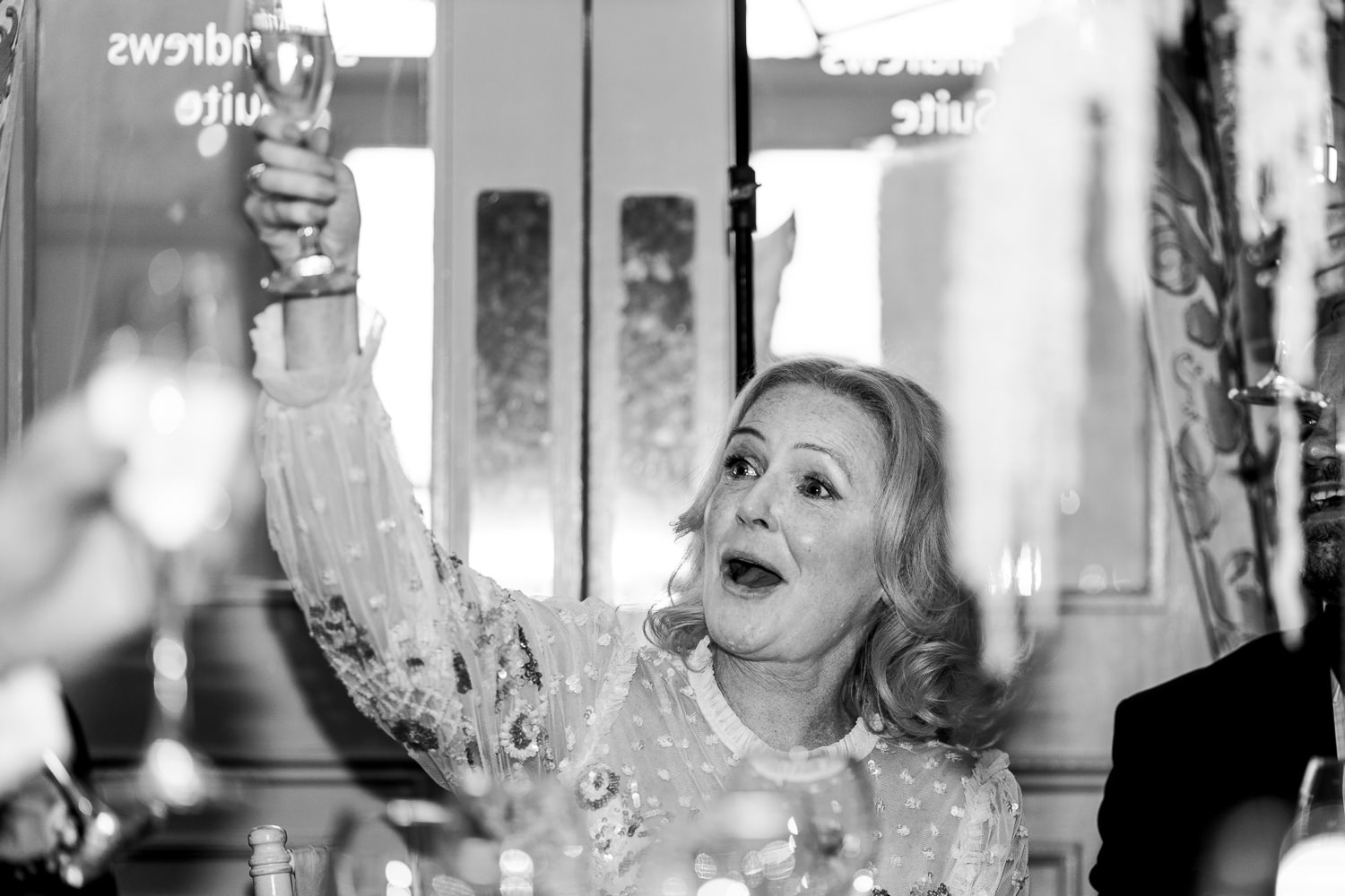 Mother of bride raising a glass