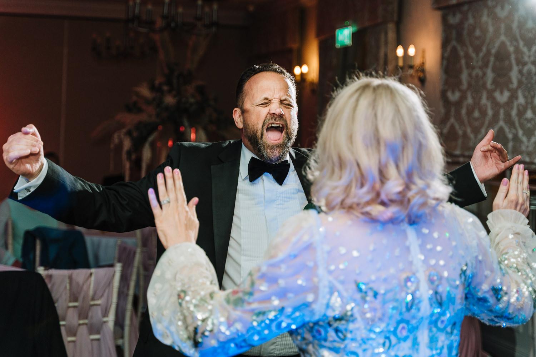 brides mum and step dad dancing.