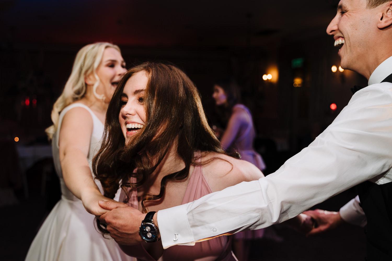 Bridesmaid dancing at Mottram Hall
