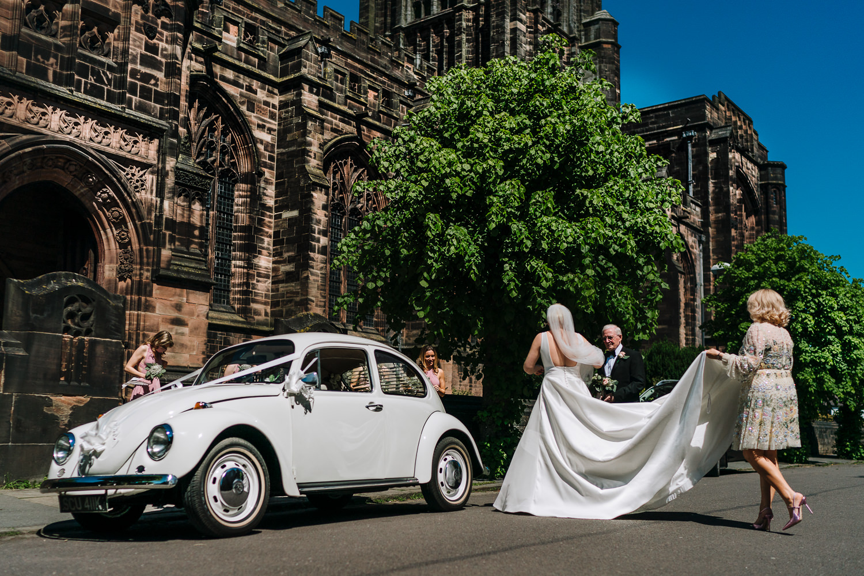 Bride walking into church