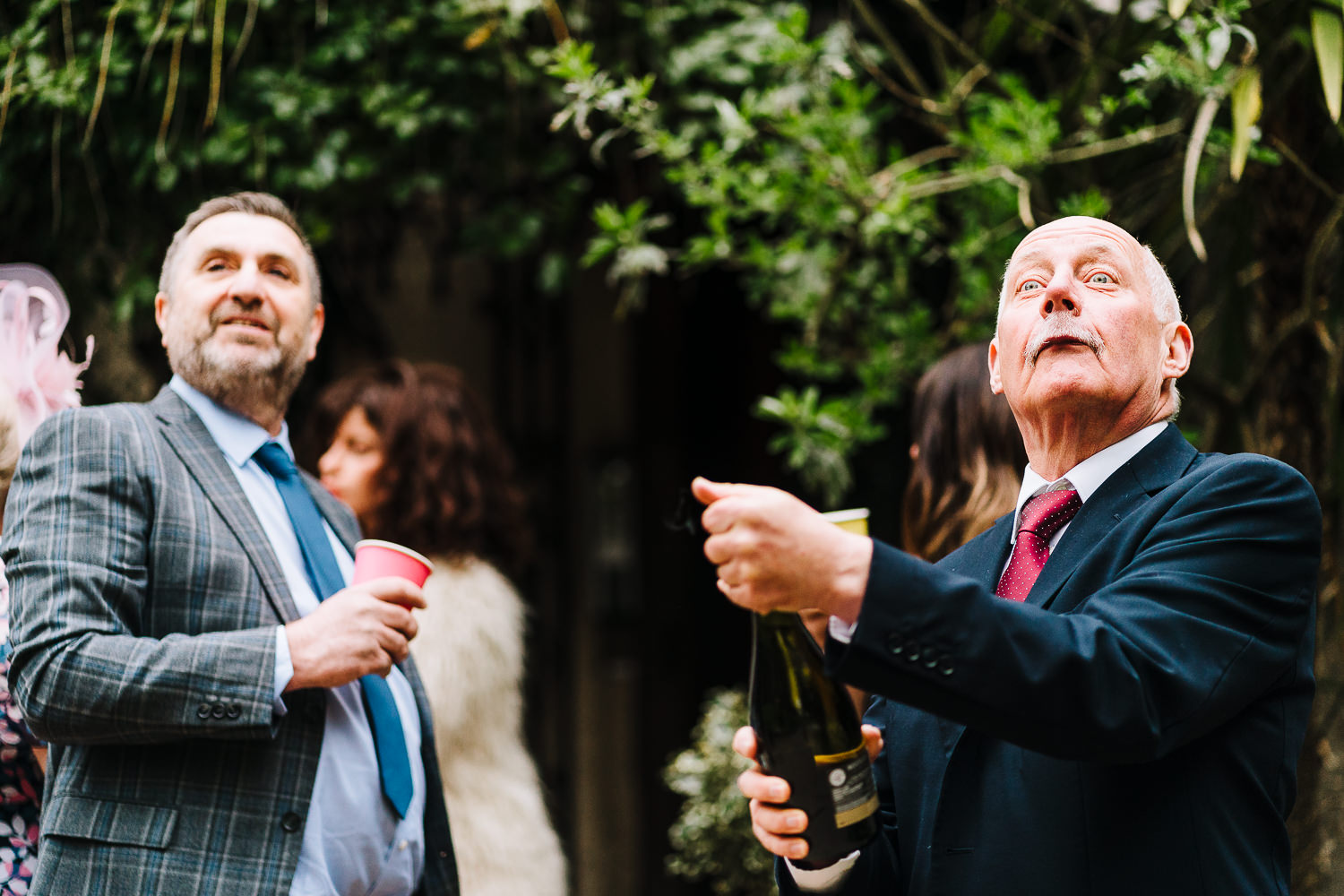 Father of the groom opening up Prosecco