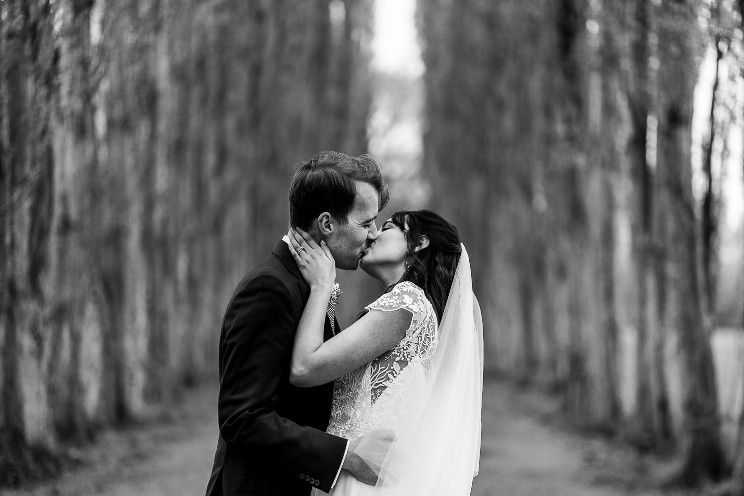 Bride and groom kissing at Fletcher Moss