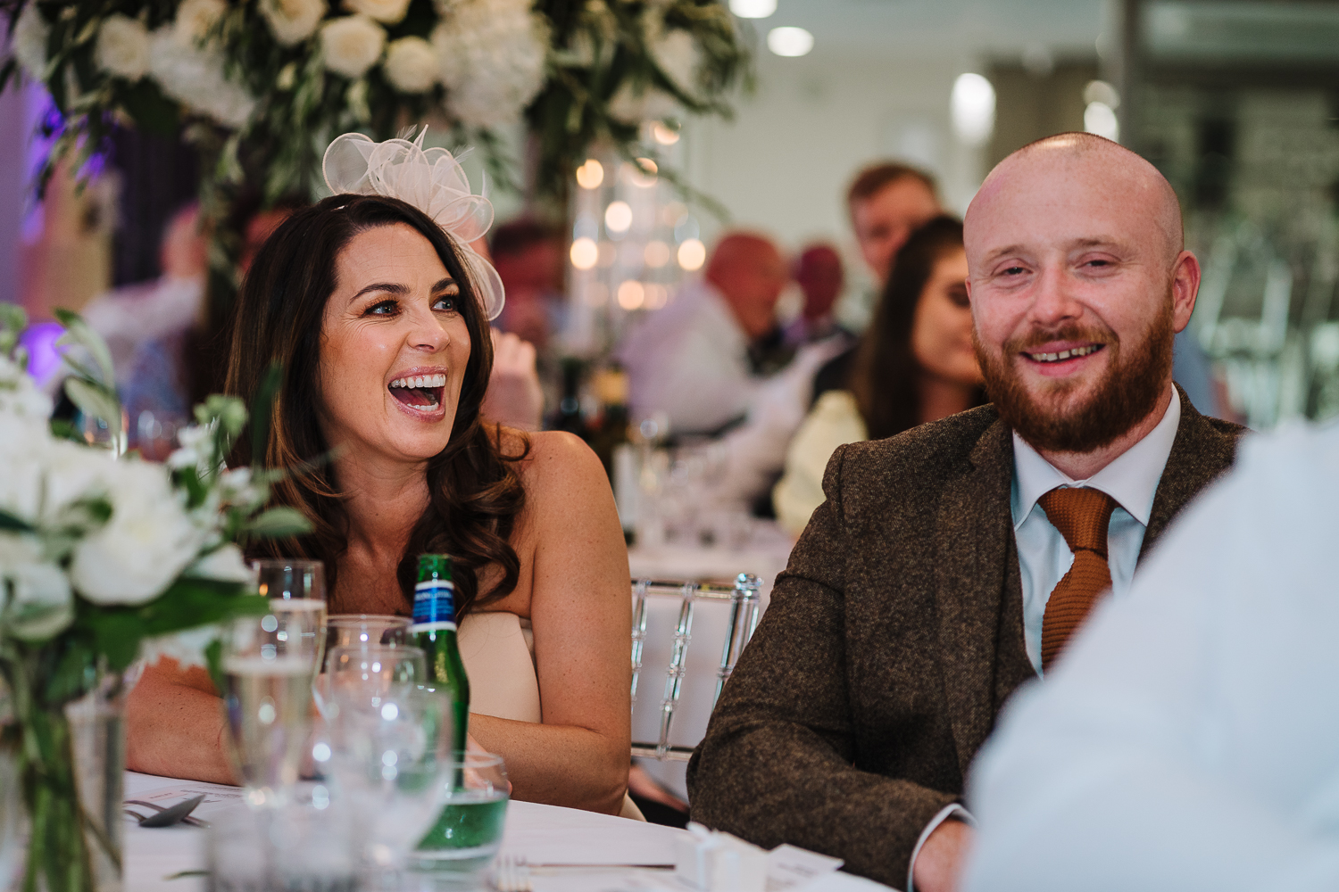 Wedding guests laughing at Merrydale Manor