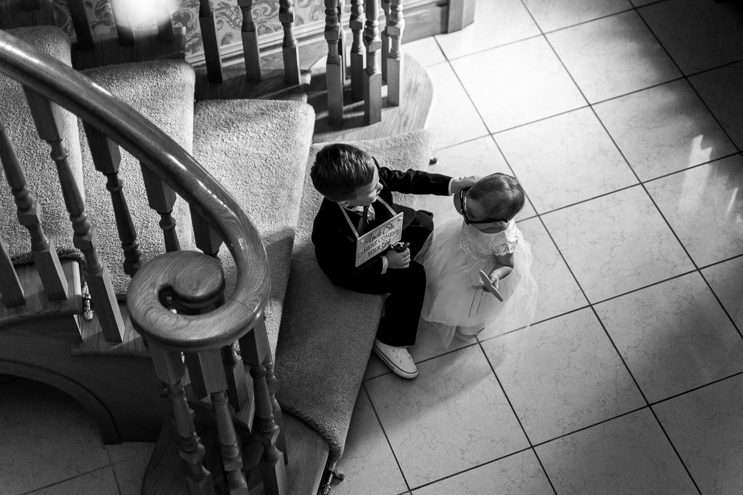Flower girl and page boy on the stairs of Merrydale Manor